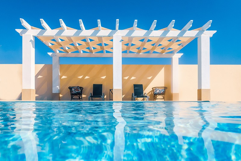 beautiful pergola by a swimming pool